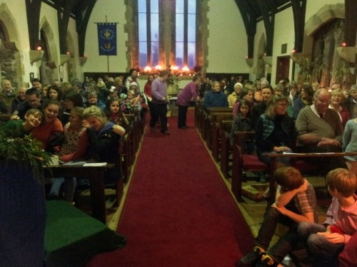 The Church fills for the Christingle Service on Christmas Eve