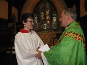 """The Rector thanks Lowena Lindsay for her years as a Server at St Ninian's and wishes her well as she heads off to St Andrew's University (""""the best one"""", he says) to study medicine."""