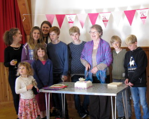 Ann Gault cuts her birthday cake while youngsters from the Sunday School stand by in anticipation. The adult members of the congregation were more restrained!