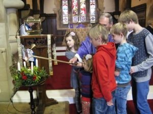 Youngsters from the Sunday School light the first two Advent candles