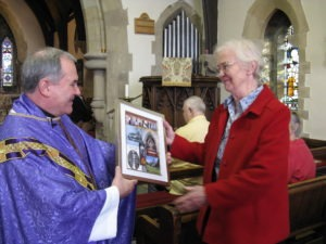 The Rector gives Vivien a memento from St Ninian's, to warm applause from the congregation