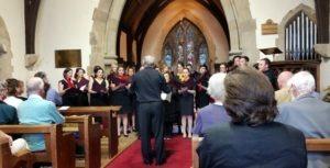 Bexley Phoenix Choir with their conductor, John MacKenzie
