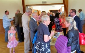 Some of the congregation and visitors in the Hall sharing in the celebration