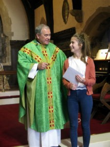 Katie receives her gift from the Rector and St Ninian's