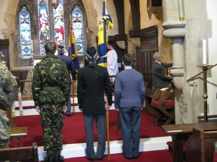 The old and new Royal British Legion Standards are paraded through the church