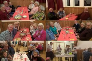 Everyone relaxing at their tables after a good supper and the draw for the raffle prizes takes place