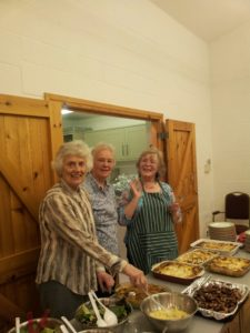 Jenny, Vivien and Alison all ready to serve the food, which was all cooked by Alison