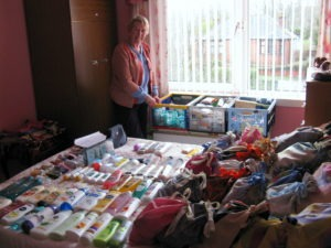 Marjorie with the toiletries donated by members of St Ninian's congregation and destined for the Women's Aid Refuges in Newton Stewart and Stranraer